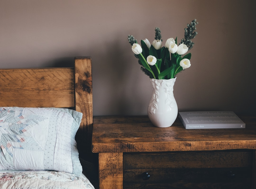 A vase of flowers sitting on top of a wooden table